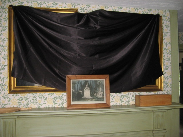 Black canvas covered mirror