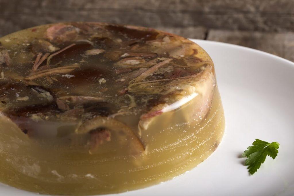 Romanian food for Christmas pork aspic with garlic